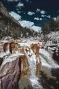 Waterfall of Ganges River flows across the Gangotri town Royalty Free Stock Photo