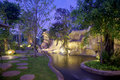 Waterfall in the garden at night Royalty Free Stock Photo