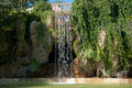 Waterfall and grotto in the Genoves park Stock Photo