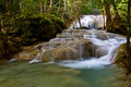 Waterfall have fish erawan waterfal in water small in kanchanaburi thailand Royalty Free Stock Image