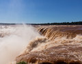 Waterfall at iguassu falls flood swollen river leading to famous on border between brazil and argentina Royalty Free Stock Photos