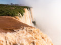 Waterfall at iguassu falls flood swollen river leading to famous on border between brazil and argentina Royalty Free Stock Photo