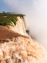 Waterfall at iguassu falls flood swollen river leading to famous on border between brazil and argentina Stock Photo