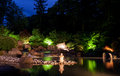 Waterfall in japanese garden at night Royalty Free Stock Photo