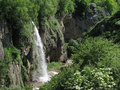 Waterfall in a mountain valley Stock Photography
