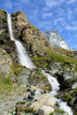 Waterfall natural in the upper valley of the matterhorn Stock Image