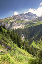 Waterfall near Klausen Pass in Swiss Alps Stock Image