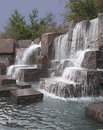 Waterfall over granite blocks Royalty Free Stock Photos