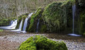 Waterfall over mossy rocks lathkill dale in the derbyshire dales england Royalty Free Stock Image