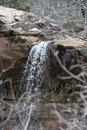 Waterfall Over Redrock Sandstone at Zion National Park in Southern Utah Royalty Free Stock Photo