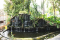 Waterfall pond out door houes Royalty Free Stock Photo