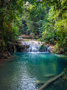 Waterfall in the rainforest erawan national park thailand Stock Photography