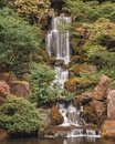 Waterfall and reflection pond in the Portland Japanese Garden Royalty Free Stock Photo