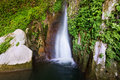 Waterfall in rocky grot Royalty Free Stock Photo