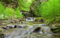 Waterfall on small forest river Royalty Free Stock Photography