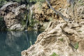 Waterfall with small lake called pegos do inferno hells pond near tavira beautiful in famous hidenn natural picnic área algarve Royalty Free Stock Images