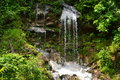 Waterfall small in the mountains Stock Photography
