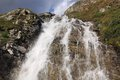 Waterfall at stausee the reservoir switzerland Stock Photography