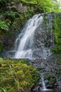 Waterfall on the summer day, shoot with long exposure to give water silky smooth look Royalty Free Stock Photo