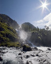 Waterfall and sun Royalty Free Stock Photo
