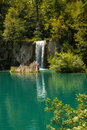 Waterfall to the turquoise lake Royalty Free Stock Photo