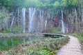 Waterfall and tourist path in plitvice lakes park near the national Royalty Free Stock Photos
