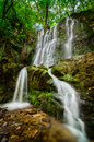 Waterfall tranquil scene of beautiful hidden deep in the forest Stock Photos