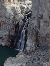 Waterfall trickling through water makes its way the rocks Royalty Free Stock Photos
