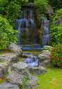 Waterfall in tropical zen garden Royalty Free Stock Photo