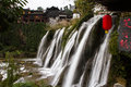 Waterfall under the ancient architecture at Furong Town of China Royalty Free Stock Photo