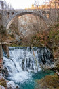 Waterfall under a bridge Royalty Free Stock Photo