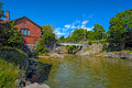 Waterfall in Vanhankaupunginkoski and old power station, Helsink Royalty Free Stock Photo