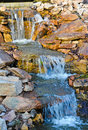 Waterfall water cascading over stone feature Stock Images