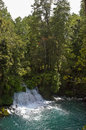Waterfall water jump caburga eyes in pucon the araucania region chile Royalty Free Stock Photography