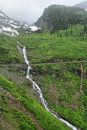Waterfalls along the going to the sun road in glacier national park Stock Photos