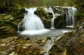 Waterfalls amazing in a wooded mountainous landscape Royalty Free Stock Image