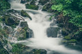 Waterfalls at mountain river in colorful forest. Royalty Free Stock Photo