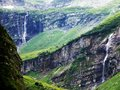 Waterfalls Oberer Jetzbachfall and Wannenbachfall in the alpine valley of Im Loch