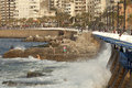 Waterfront beirut people on the rocks with the waves lapping the sea wall Royalty Free Stock Images