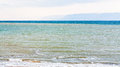 Waterfront of Dead Sea in winter morning Royalty Free Stock Photo