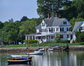 Waterfront houes houses and boats reflected in water Royalty Free Stock Image