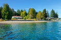 Waterfront house in Northwest with water and fall beach. Royalty Free Stock Photo
