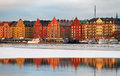 Waterfront kungsholmen stockholm in winter colourful buildings reflecting water Royalty Free Stock Photography