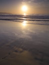 Waterfront sunrise above the atlantic ocean seen from a beach in playa del ingles Stock Photography