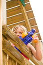 Watergun fight little girl in wooden fort with water gun Stock Images