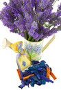 Watering can with lavender sachet on white Stock Image