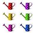 Watering can. Set of children s watering cans in different colors. objects. White background. Vector