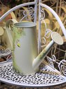 Watering can on the shelf Stock Image