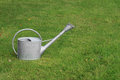 Watering can watering pot on the grass Royalty Free Stock Photography