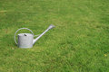 Watering can watering pot on the grass Royalty Free Stock Photos